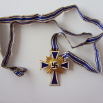 Крест матери в золоте